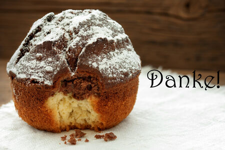 peccadillo: Homemade And Baked Chocolate Cake On Wooden Background With German Word Danke Which Means Thank You