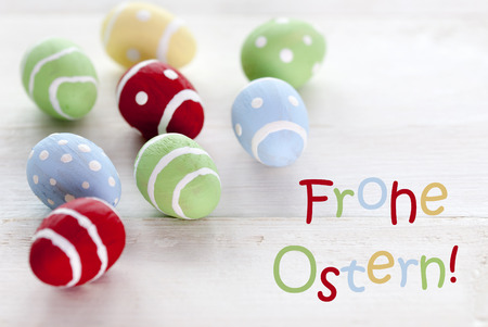 Ostern: Many Colorful Easter Eggs Which Are Dotted And Striped On Wooden Vintage Background With German Text Frohe Ostern Which Means Happy Easter For Easter Greetings