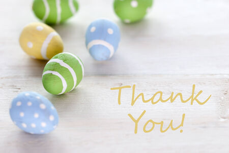 thankfulness: Blue Green And Yellow Easter Eggs Which Are Dotted And Striped On Wooden Vintage Background With English Text Thank You For Easter Greetings Stock Photo