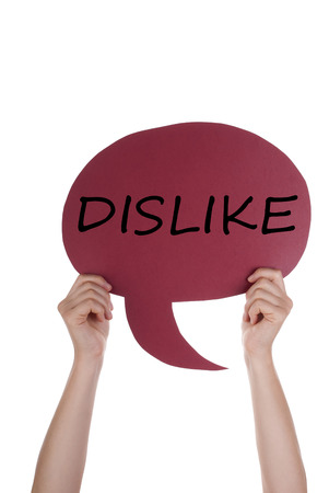 dislike it: Two Hands Holding A Red Speech Balloon Or Speech Bubble With English Text Dislike Isolated On White