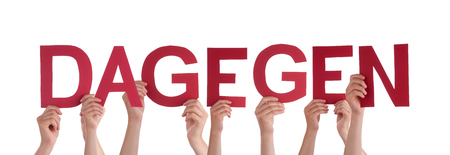 dislike it: Many Caucasian People And Hands Holding Red Straight Letters Or Characters Building The Isolated German Word Dagegen Which Means Against It On White Background Stock Photo