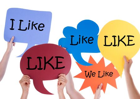 like english: Many Hands Holding Colorful Speech Balloons Or Speech Bubbles With English Word Like Isolated On White