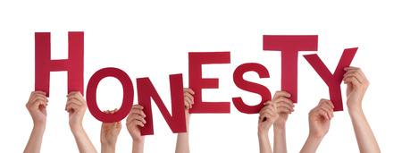valores morales: Muchas personas cauc�sicas Y Manos celebraci�n rojo letras o caracteres construcci�n de la aislada Honestidad Ingl�s de Word en el fondo blanco Foto de archivo