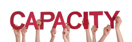 capacities: Many Caucasian People And Hands Holding Red Straight Letters Or Characters Building The Isolated English Word Capacity On White Background Stock Photo