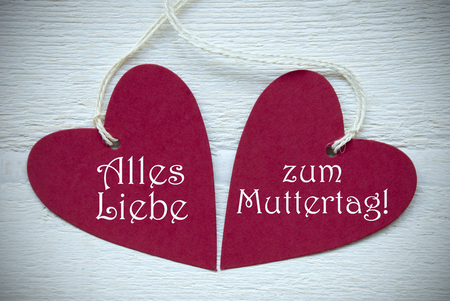 Liebe: Two Red Hearts Label Or Tag With White Ribbon On White Wooden Background With German Text Alles Liebe Zum Muttertag Means Happy Mothers Day Vintage Retro Or Rustic Style With Frame
