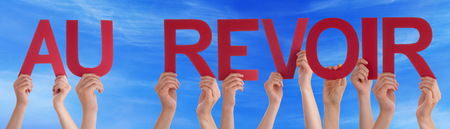 au: Many Caucasian People And Hands Holding Red Straight Letters Or Characters Building The French Word Au Revoir Which Means Goodbye On Blue Sky Stock Photo
