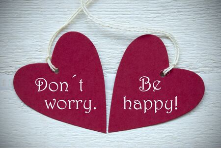 dont worry: Two Red Hearts Label Or Tag With White Ribbon On White Wooden Background With English Text Dont Worry Be Happy Vintage Retro Or Rustic Style With Frame