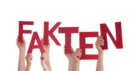 Many Caucasian People And Hands Holding Red Letters Or Characters Building The Isolated German Word Fakten Which Means Fact On White Background photo
