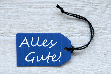 best wishes: Blue Label Or Tag With Black Ribbon On White Wooden Background With German Text Alles Gute Which Means Best Wishes Vintage Retro Or Rustic Style