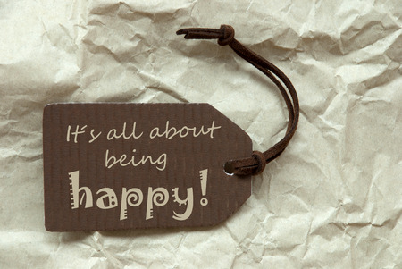 creasy: One Brown Label Or Tag With Brown Ribbon On Crumpled Paper Background With English Life Quote Its All About Being Happy Vintage Or Retro Style