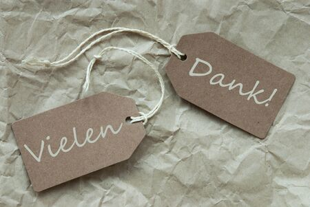 creasy: Two Beige Labels Or Tags With White Ribbon On Crumpled Paper Background With German Text Vielen Dank Means Thank You Vintage Or Retro Style Stock Photo