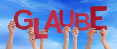 glaube: Many Caucasian People And Hands Holding Red Letters Or Characters Building The German Word Glaube Which Means Belief On Blue Sky