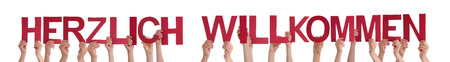 willkommen: Many Caucasian People And Hands Holding Red Straight Letters Or Characters Building The Isolated German Word Herzlich Willkommen Which Means Welcome On White Background