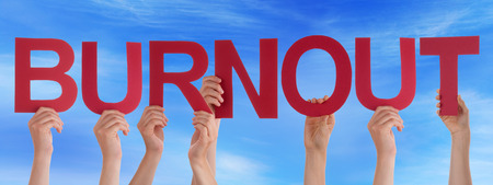 coping: Many Caucasian People And Hands Holding Red Straight Letters Or Characters Building The English Word Burnout On Blue Sky Stock Photo