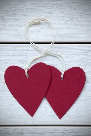 Vertical Image With Two Empty Red Hearts Label With White Ribbon On White Wooden Background With Copy Space Your Text Here Or Free Text For Advertisement Vintage Retro Or Rustic Style With Frame photo