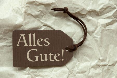 best wishes: One Brown Label Or Tag With Brown Ribbon On Crumpled Paper Background With German Text Alles Gute Means Best Wishes Vintage Or Retro Style Stock Photo