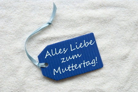 in liebe: One Blue Label Or Tag With Light Blue Ribbon On White Sand Background With German Text Alles Liebe Zum Muttertag Which Means Happy Mothers Day