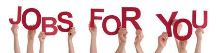 Viele Menschen kaukasischen und Hände, die rote Buchstaben oder Zeichen Building The Isolated englischen Wort Jobs für Sie auf weißem Hintergrund