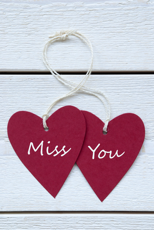 Vertical Image With Two Red Hearts Label With White Ribbon On White Wooden Background With English Text Miss You Vintage Retro Or Rustic Style photo