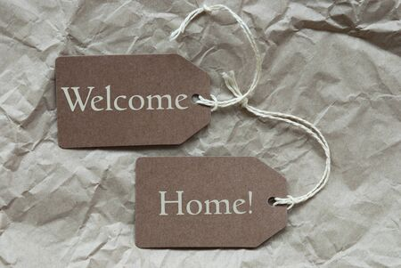 welcome home: Two Brown Labels Or Tags With White Ribbon On Crumpled Paper Background With English Text Welcome Home Vintage Or Retro Style