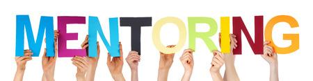 Viele Menschen kaukasischen Und Hände halten bunte Gerade Buchstaben oder Zeichen Building The Isolated English Word Mentoring auf weißem Hintergrund Lizenzfreie Bilder