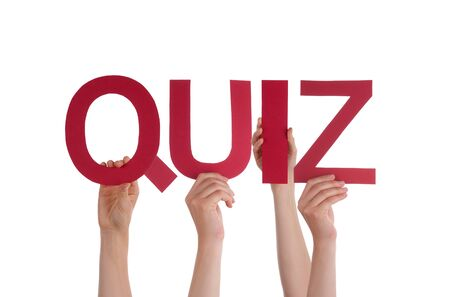 Many Caucasian People And Hands Holding Red Straight Letters Or Characters Building The Isolated English Word Quiz On White Background photo
