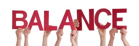 Many Caucasian People And Hands Holding Red Straight Letters Or Characters Building The Isolated English Word Balance On White Background