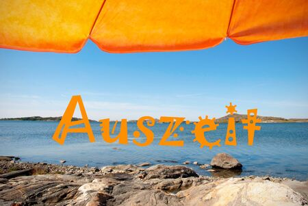 german ocean: Swedish Coastline Bohuslan Archipelago Close To Gothenburg Swedish West Beach And Coast With Rocks And Cliffs With Orange Parasol And German Text Auszeit Means Downtime With Ocean And Open Sea Sunny Weather With Blue Sky