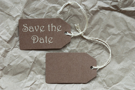 creasy: Two Brown Labels Or Tags With White Ribbon On Crumpled Paper Background With English Text Save The Date Vintage Or Retro Style Stock Photo