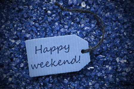 One Blue Label Or Tag With Black Ribbon On Blue And Purple Small Stones As Background With English Text Happy Weekend With Frame photo