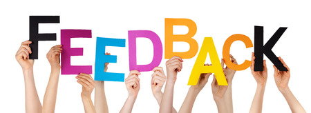 Many Caucasian People And Hands Holding Colorful  Letters Or Characters Building The Isolated English Word Feedback On White Background