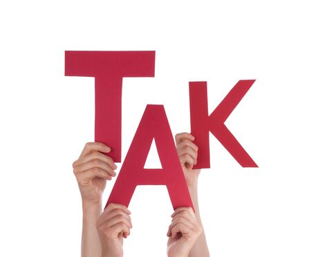 Many Caucasian People And Hands Holding Red Letters Or Characters Building The Isolated Danish Word Tak Which Means Thanks On White Background Stock Photo