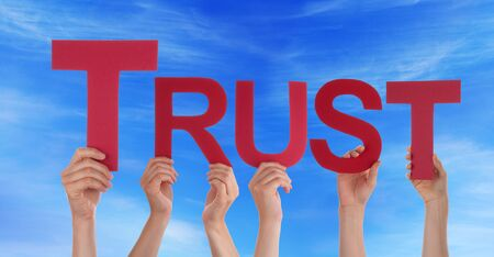 trust people: Many Caucasian People And Hands Holding Red Straight Letters Or Characters Building The English Word Trust On Blue Sky
