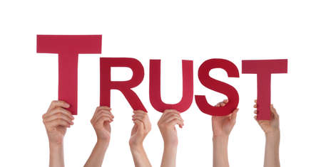 trust people: Many Caucasian People And Hands Holding Red Straight Letters Or Characters Building The Isolated English Word Trust On White Background Stock Photo