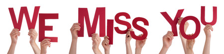 Many Caucasian People And Hands Holding Red Letters Or Characters Building The Isolated English Word We Miss You On White Background