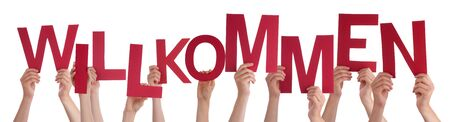willkommen: Many Caucasian People And Hands Holding Red Letters Or Characters Building The Isolated German Word Willkommen Which Means Welcome On White Background Stock Photo