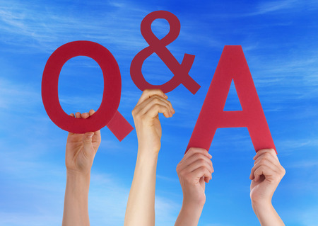Many Caucasian People And Hands Holding Red Letters Or Characters Building The English Word Q And A Means Questions And Answers On Blue Sky photo