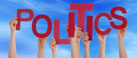 politics: Many Caucasian People And Hands Holding Red Letters Or Characters Building The English Word Politics On Blue Sky Stock Photo