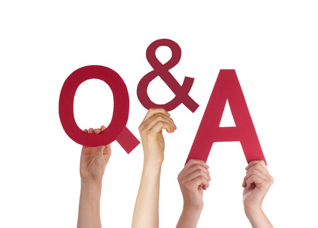Many Caucasian People And Hands Holding Red Letters Or Characters Building The Isolated English Word Q And A Means Questions And Answers On White Background photo