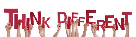 think different: Many Caucasian People And Hands Holding Red Letters Or Characters Building The Isolated English Word Think Different On White Background Stock Photo