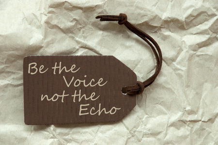 to be or not be: One Brown Label Or Tag With Brown Ribbon On Crumpled Paper Background With English Life Quote Be The Voice Not The Echo Vintage Or Retro Style Stock Photo