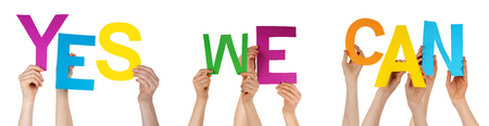 we the people: Many Caucasian People And Hands Holding Colorful Letters Or Characters Building The Isolated English Word Yes We Can On White Background