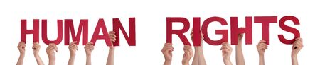 Many Caucasian People And Hands Holding Red Straight Letters Or Characters Building The Isolated English Word Human Rights On White Background photo