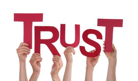 trust people: Many Caucasian People And Hands Holding Red Letters Or Characters Building The Isolated English Word Trust On White Background
