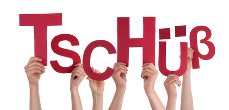 Many Caucasian People And Hands Holding Red Letters Or Characters Building The Isolated German Word Tschuess Which Means Bye On White Background