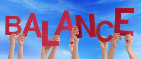 time deficit: Many Caucasian People And Hands Holding Red Letters Or Characters Building The English Word Balance On Blue Sky