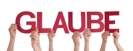 glaube: Many Caucasian People And Hands Holding Red Straight Letters Or Characters Building The Isolated German Word Glaube Which Means Belief On White Background