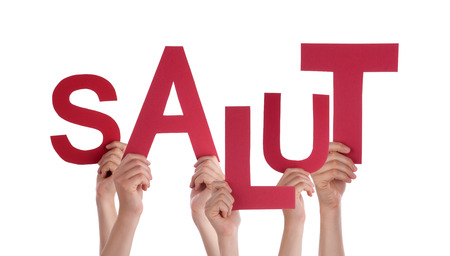 salut: Many Caucasian People And Hands Holding Red Letters Or Characters Building The Isolated French Word Salut Which Means Hello On White Background