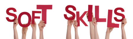 Many Caucasian People And Hands Holding Red Letters Or Characters Building The Isolated English Word Soft Skills On White Background