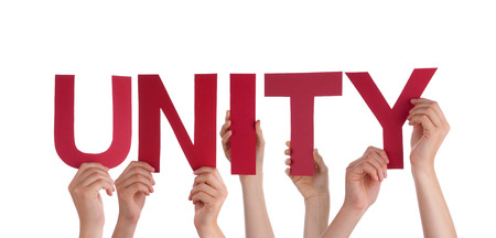 Many Caucasian People And Hands Holding Red Straight Letters Or Characters Building The Isolated English Word Unity On White Background